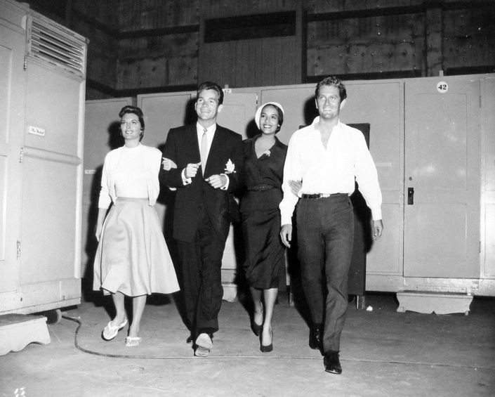 Julie London, Dean Jones, Anna Kashfi and John Drew Barrymore caught in a nice candid shot while in the studio filming Night of The Quarter Moon in 1959.