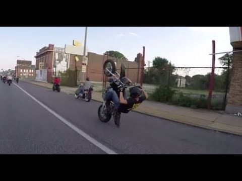 Showoff Harley Rider Smashes Into a Light Pole While Riding Down Sidewalk