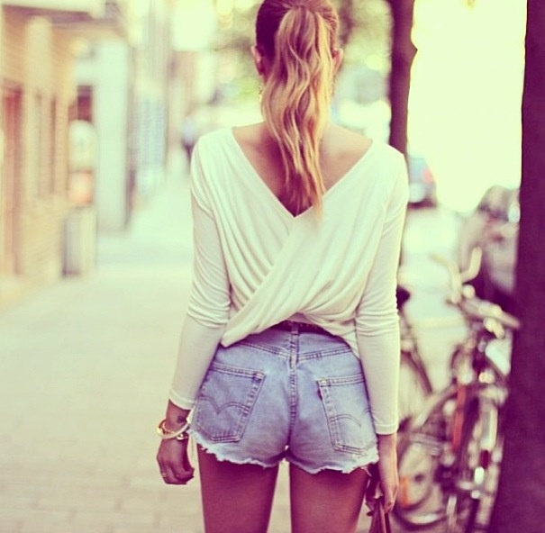 I love this look. Cute draping back with an exposing pony - accented by some high rise denim! cute! Which shoes??