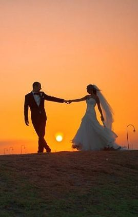 Sunset wedding photography>> Usually they have the picture of the bride leading the groom but I feel like the man should always be the one leading everything so I like this picture much better. :)