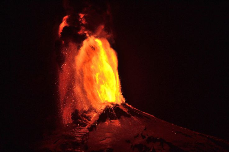 Ash and lava spew from the volcano, as seen from Pucon, Chile.