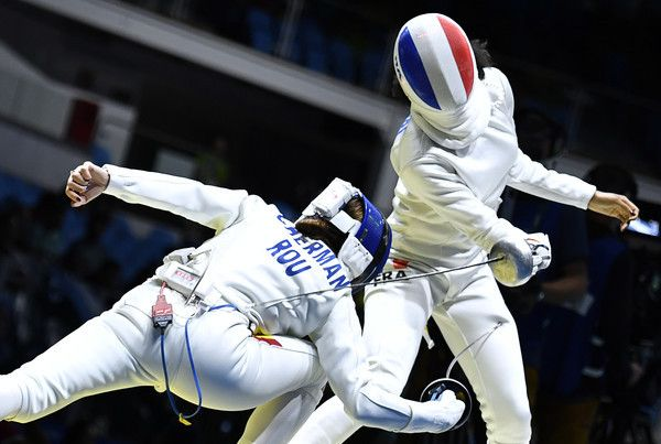 modernfencing:    [ID: two epee fencers in-fighting.]  Simona Gherman (left) against Lauren Rembi at the 2016 Olympics!