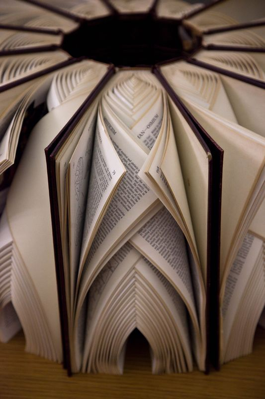 """Between"" by Math Monahan.   Intertwined pages naturally form intricate book sculptures.   For more info click link."