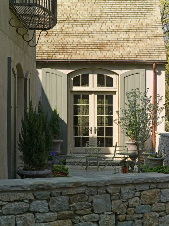 House Shutter Colors Decoration Ideas: Rustic Patio With Double Arched Door And Grey House Shutter Colors ~ dropddesign.com Doors Inspiration