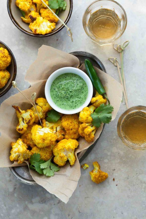 Turmeric roasted cauliflower served with cilantro chutney is an easy appetizer or side dish with lots of bright color and flavor.