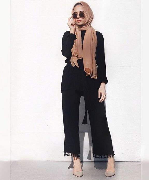 Pinterest: @eighthhorcruxx. Hijabioffthegrid - wearing black jumpsuit, heels, tan hijab and sunglasses