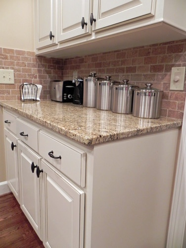 These Cabinets Are Glazed With A Brown Glaze That Compliments The Granite Countertops And