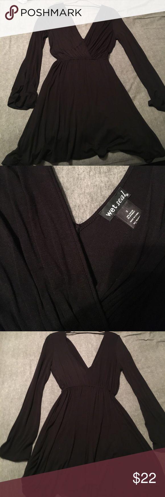 Wet Seal black dress Wet Seal black dress. Plunging neck line, flowy bottom & flowy long sleeves. Great condition. Wet Seal Dresses Long Sleeve