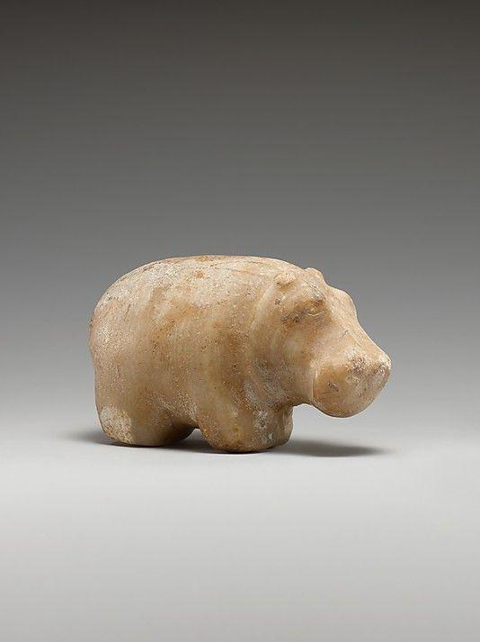 Hippopotamus: Early Dynastic Period ca. 3100–2649 B.C. Egypt, Northern Upper Egypt, Abydos (Umm el-Qaab, Tell el-Manshiya, others), Osiris Temple M89; Medium:Egyptian alabaster. On display in Gallery 964 of the Metropolitan Museum of Art.
