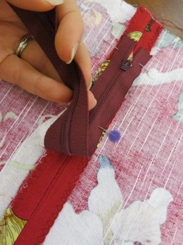 Laying the zip along the seam, checking that the coils exactly follow the seamline
