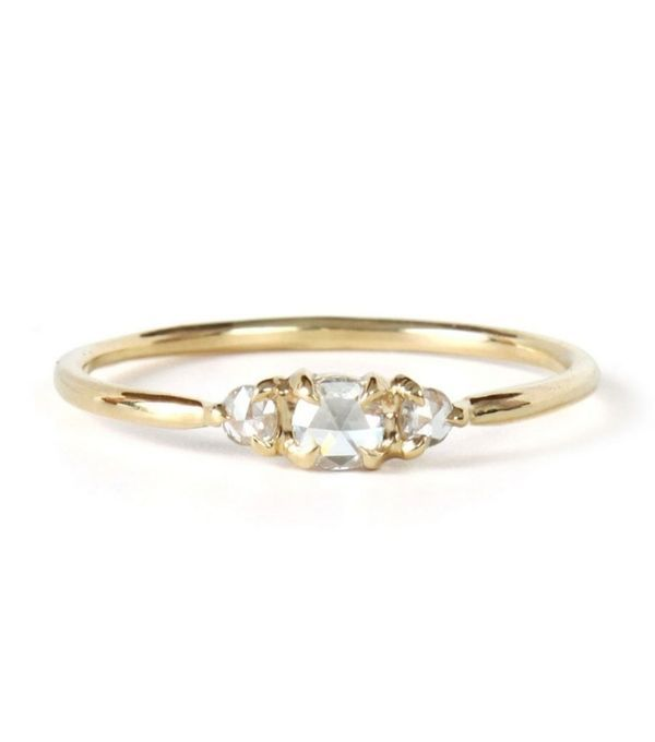 Three diamond engagement ring with yellow gold band, $438. Perfect for the minimalist lovers. | Budget Friendly Engagement Rings Under $1000