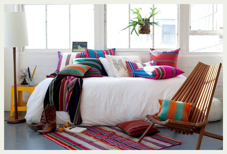 Comfy daybed, mounted fern, mixed prints, kilim rug and deck chair. The perfect chill out space.
