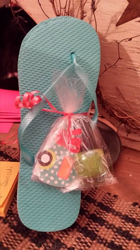 Summer party favors: a pair of flip-flops, a Thirty-One nail file and a bottle of nail polish in a fun color.