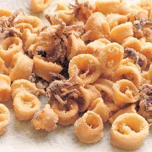 Calamari: 3/4 c mayo, 1 minced garlic clove, 1 tsp smoked paprika, Sea salt, 1 pound squid bodies and tentacles, canola oil for deep-frying, 1/2 c yellow cornmeal, 1/2 c semolina flour