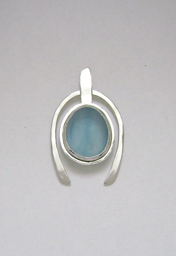 The rare blue End of Day multi is genuine. It was found on a beach in England and is no back bezel set. The pendant is handmade of sterling silver