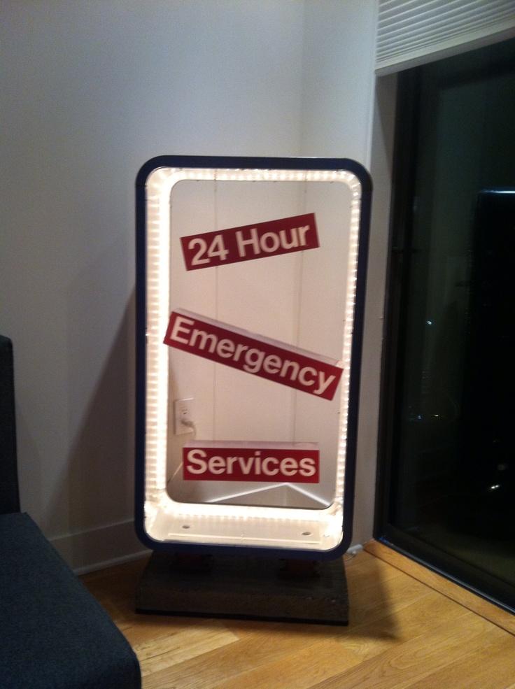 """ER"" salvaged emergency sign reconfigured and lights installed"