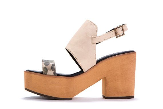 //Sale 50% off >> Original Price 288$  70s style platform sandals, with a modern chic. Extremely comfortable, looks great with casual spring outfit.  The shoes are made of soft, premium leather, and the ankle strap is equipped with a small buckle that can be fitted comfortably to any size. The platform is made out of EVA, very light and comfortable outsole material. Model: Andrea Heel: 3.9 / 10 cm back. 1.57 / 4 cm Front. Material: genuine leather size : 35-41  Size ...