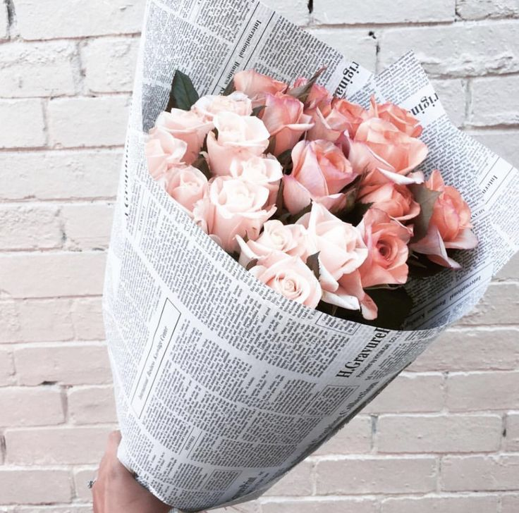 Bouquet of flowers in newspaper