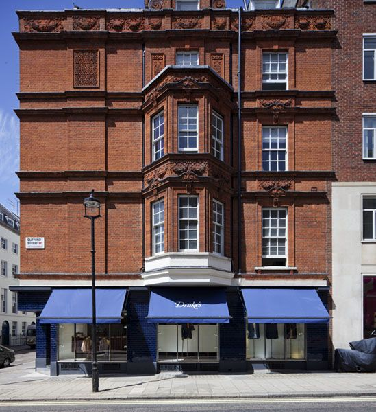 Exterior frontage of Drake's store on Clifford Street with blue awnings - William Russell
