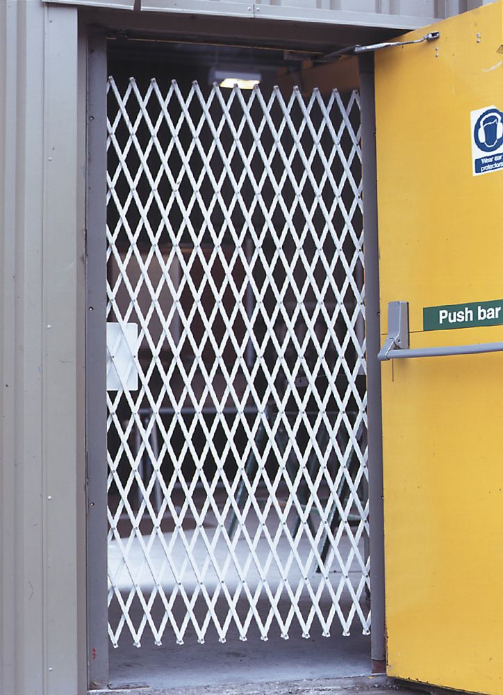 Fire Exit Security Grille has been specially designed with thumbturn lock for emergency escape. www.securitydirect.uk.com//security-grilles/retractable-grilles/fire-exit-door-security-grille #fireexit #securitydoor #securitygrille #fireexitsecurity