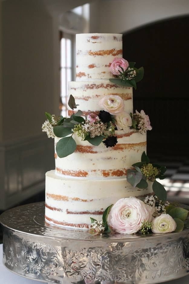 We love this rustic wedding cake with beautiful real flower decoration. www.wed2b.co.uk
