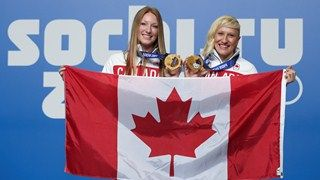 Kaillie Humphries and Heather Moyes, repeat bobsled champions  named Canadian flag-bearers for Olympics Closing Ceremonies.