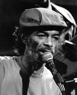 """Gil Scott-Heron - His music, most notably on Pieces of a Man and Winter in America in the early 70s, influenced and helped engender later African-American music genres such as hip hop & neo soul Scott-Heron remained active until his death, in 2010 released his 1st new album in 16yrs, entitled I'm New Here. His recording work received much critical acclaim, especially one of his best-known compositions """"The Revolution Will Not BeTelevised"""". His style influenced every generation of hip hop."""