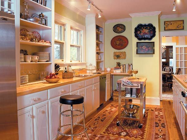 Practical design solutions create a pleasing and for Pictures of galley kitchens with islands