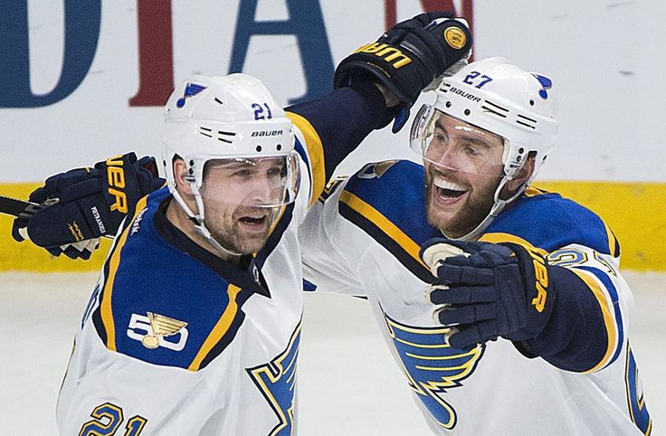 St. Louis Blues center Patrik Berglund (21) celebrates with defenseman Alex Pietrangelo (27) after scoring against the Montreal Canadiens during the second period of an NHL hockey game Saturday, Feb. 11, 2017, in Montreal