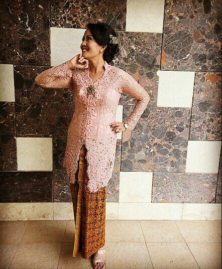 This is Modern Javanese Kebaya. We only wear this kebaya traditionaly on special occassion, such as family party or wedding ceremony. I love kebaya Indonesia. It reminds me how my great great grandmothers used to wear this during their time and they still could be so energetic doing their activity. While I have to watch my walk whenever I'm wearing this outfit. It's so classy, elegant and fashionable traditional outfit. (bernadet_ika@gmail.com)