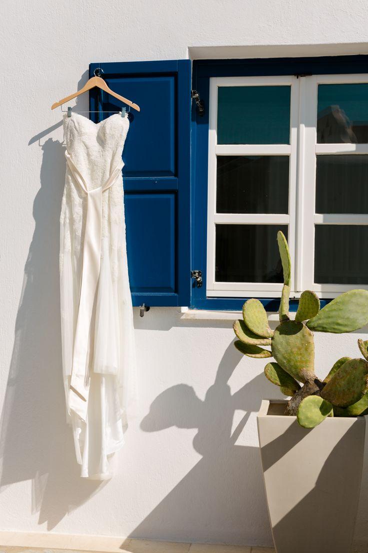 Wedding dress by blue shutters in Mykonos Grand Luxury Hotel