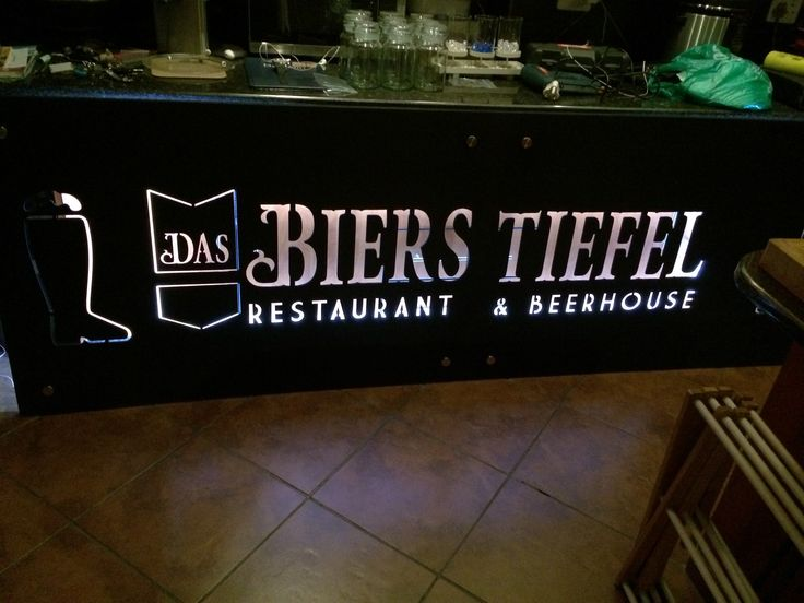 Custom sign under bar counter for client's new restaurant