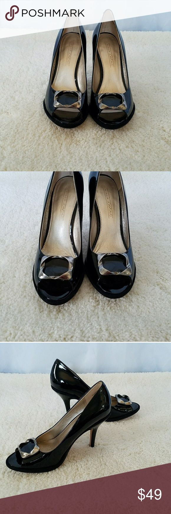"JOAN & DAVID BLACK PATENT LEATHER PEEP TOE PUMPS JOAN & DAVID BLACK PATENT LEATHER CAREER OPEN  TOE CAREER HEELS with pewter hardware over toe area,  Size 7.5. This on trend shoe has a patent leather upper and the balance is man made. Has a 4"" heel and a 1/4"" platform. All measurements are approximate and taken flat.  So polished and professional for the office. Barely used! Joan & David Shoes Heels"