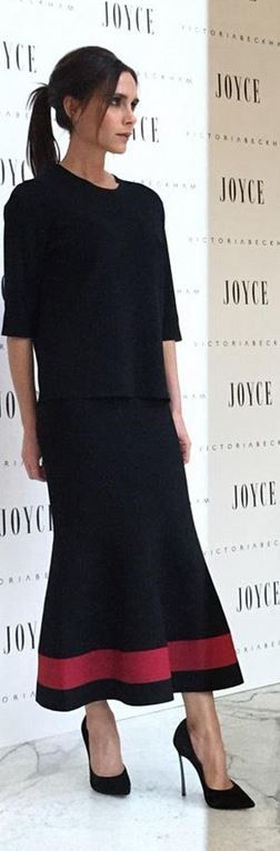 Who made Victoria Beckham's black top, white stripe skirt, and pumps? (OutfitID)