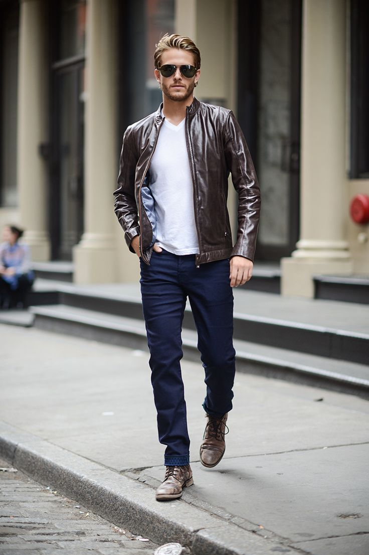 Shop this look on Lookastic:  https://lookastic.com/men/looks/bomber-jacket-v-neck-t-shirt-skinny-jeans/14526  — Black Sunglasses  — White V-neck T-shirt  — Dark Brown Leather Bomber Jacket  — Navy Skinny Jeans  — Dark Brown Leather Casual Boots