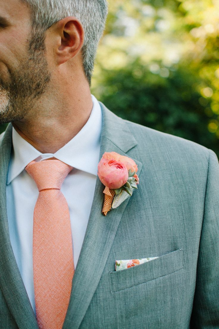 {groom} peach ranunculus & succulent  boutonniere with fishing fly. photography: http://www.megmanion.com/