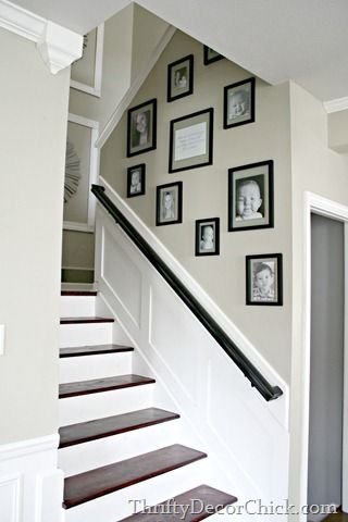 add picture frame moulding on landing - dress up and lighten up the stairway