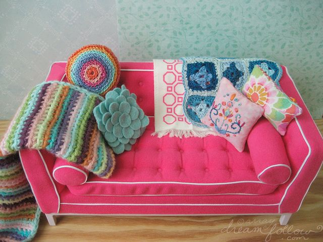 I made a bunch of colorful pillows and blankets for the girls' new couch. I actually wish it was a real human sized one! well it's inspiration anyhow. :) though I doubt we'll ever have a hot pink couch, I am working on some fun human sized pillows too. :)