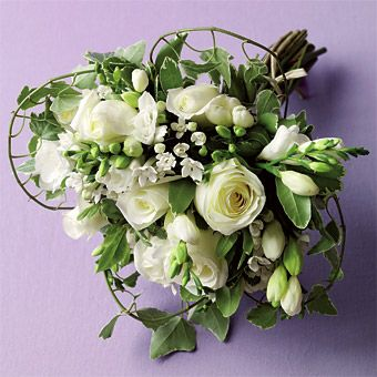 White roses, freesia and bouvardia, plus variegated pitt and trailing ivy