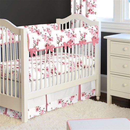 Cherry Blossom Crib Bedding by Carousel Designs.  Spring is in the air all year long with this stunning Cherry Blossom collection. You can almost smell the fragrance of the beautiful almond pink cherry blossoms. Your little lady's nursery will be the talk of the town with this unique crib bedding set.
