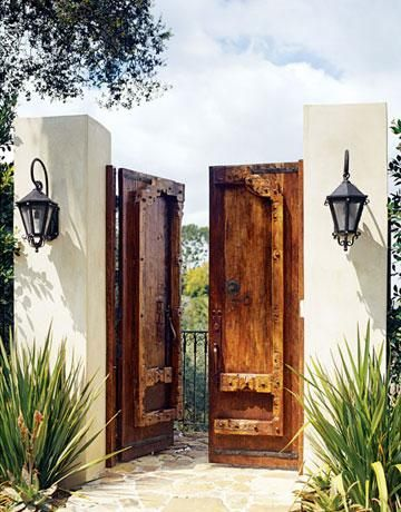 Intricate wooden doors, wrought iron detailing and adobe light posts.