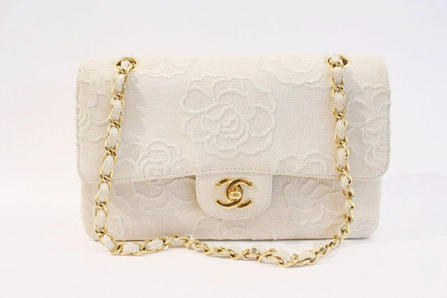 Vintage Chanel Camellia Flower Double Flap Bag http://www.riceandbeansvintage.com/collections/vintage-designer-new-arrivals/products/rare-vintage-chanel-camellia-flower-double-flap