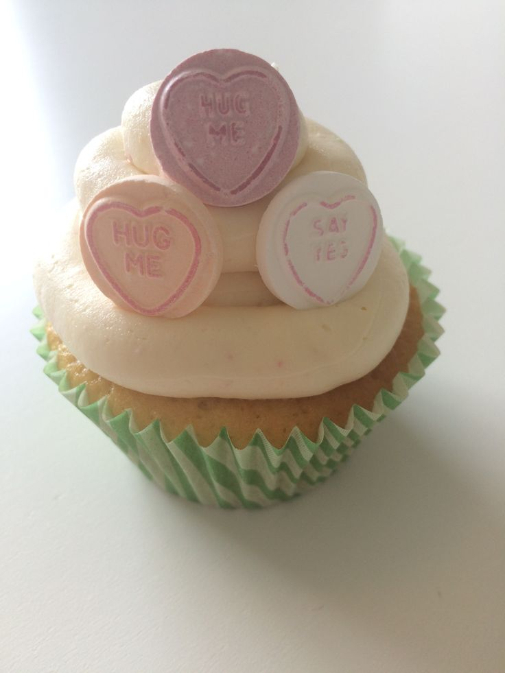 Vanilla cupcake with a loveheart-flavoured buttercream, decorated with a few loverhearts