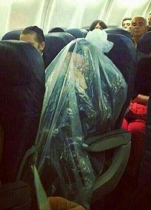Orthodox Jewish man photographed covering himself in plastic bag during flight because faith forbids him to fly over cemeteries The man dressed entirely in black beneath folds of plastic, sightly bows his head beneath the tied ends seen piled on his head. The man is a Kohein, religious descendant of the priests of ancient Israel, who are banned from flying over cemeteries. Many wrap themselves in plastic bags as a compromise measure