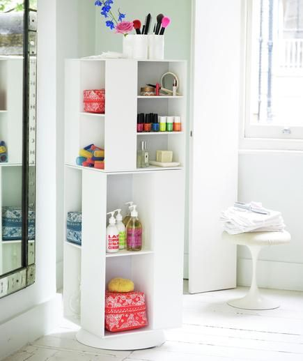 There are just so many goodies that belong in the bathroom. If you share this space, bring in a slim storage piece that has separate compartments for holding items for everyone in the household.
