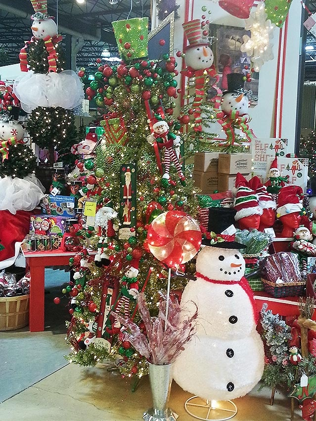 Who doesn't love a snowman, let alone one that glows from the inside-out? We set him up next to a pre-lit peppermint lollipop and kids who walk by just love him!     One of the many thousands of beautiful accents at TreeTime's Christmas showroom. www.treetime.com