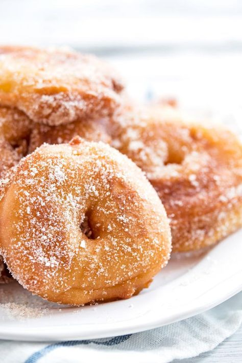 Are you looking for an easy apple fritter recipe? These are SO good! They look like fried apple donuts - the homemade batter turns out so crispy and makes your entire home smell of fall. It's the best German old fashioned treat for a golden autumn. Dip the finished rings in simple cinnamon sugar for extra deliciousness!