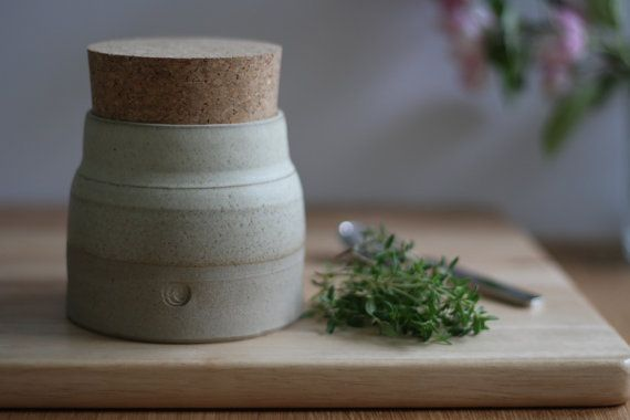 Kitchen storage jar.  Modern ceramic cream oatmeal glazed stoneware with natural cork stopper.