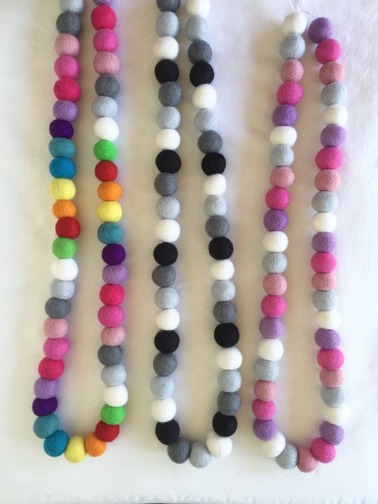 A personal favourite from my Etsy shop https://www.etsy.com/au/listing/260350551/drop-felt-ball-garland-25cm-balls-boho