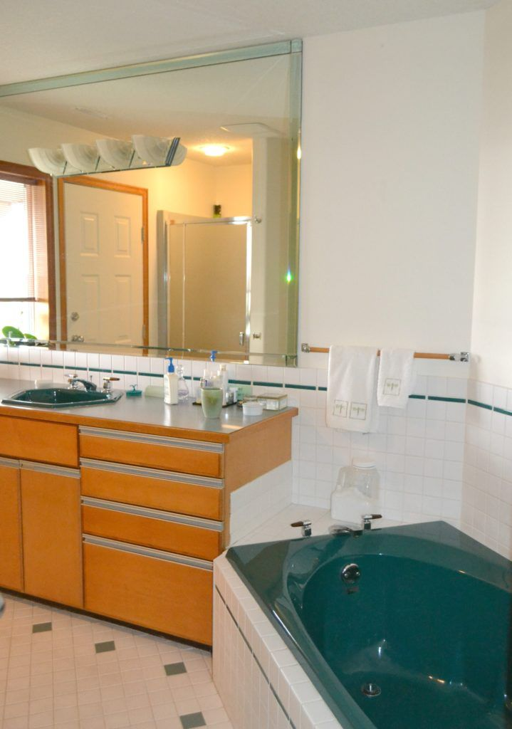 how to update and modernize forest green bathroom fixtures, tile, carpet, countertop and more by Kylie M Interiors. Ideas